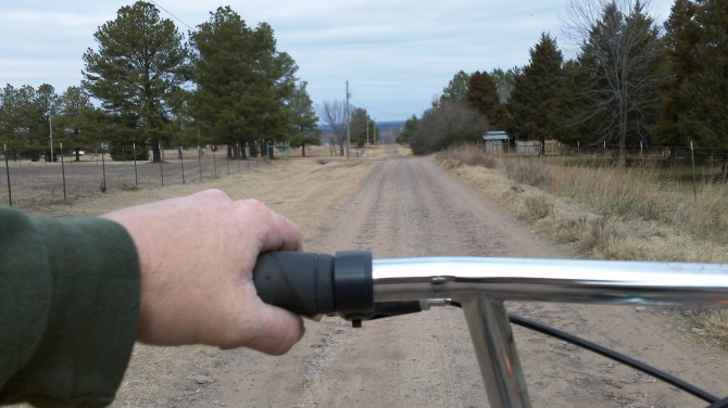 cycling a long gravel farm road