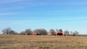 off in the distance a big red barn