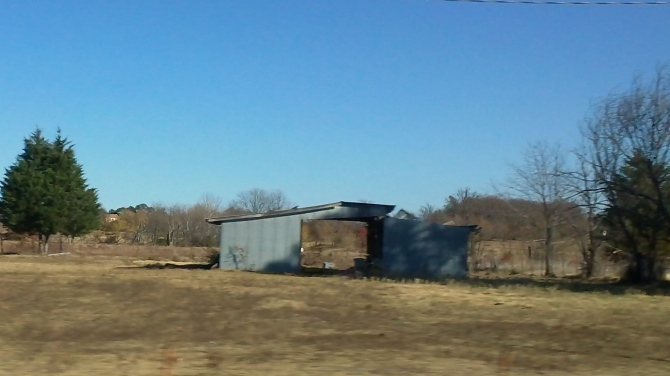 wind blown barn in the hills