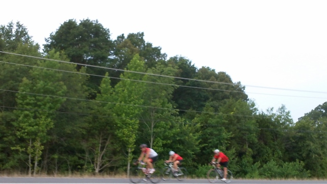 riders across the street